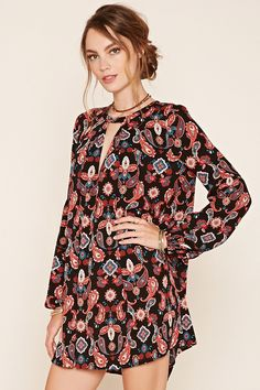 Forever 21 Contemporary - A woven shift dress featuring a paisley print, long bell sleeves with elasticized wrists, round neckline, and a pleated…