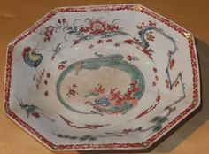 "BOW FLAMING TORTOISE PATTERN DEEP OCTAGONAL DISH C1755 Bow , circa 1755 . It is decorated in the flaming tortoise pattern . It stands at 2"" high and measures 8 7/8"" x 7"" in diameter . It has been broken into 3 pieces and has old amateur restored chips , and the restoration is discoloured   £89"