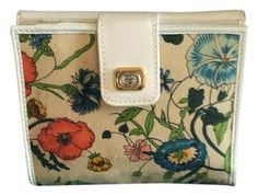 25775af0561 Gucci Flora Flower Wallet. Free shipping and guaranteed authenticity on  Gucci Flora Flower Wallet at