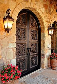 Spanish Style Door that brings a warm and masculine look. www.giselanajera.pacificsothebysrealty.com We can help you get your dream home stone look at exceptionalstone.com !