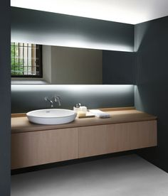 Evoluzione | Agape. Cabinet lighting above & below.