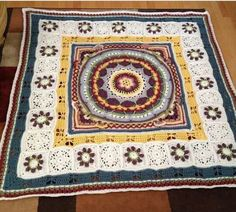 """Sophie's Garden Mandala (middle square) - [pattern on Ravelry or at Lookatwhatimade.com (don't forget to type the word """"at"""" when going to the website)] with a pattern of her own surrounding it."""