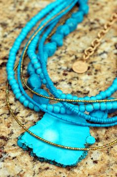 Turquoise and Gold Multi-Strand Slab Pendant Statement Necklace $295  The ultimate resort necklace!