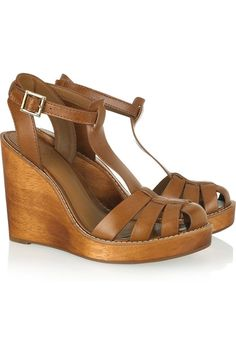 Tory Burch River sandals: light-brown leather, wooden wedge heel measures approximately 115mm/ 4.5 inches with a 25mm/ 1 inch platform, T-bar strap, cutout straps, round toe, cream stitching. Gold designer-stamped buckle fastening at ankle. Designer color: Royal Tan.
