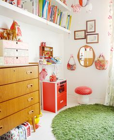 don't try to control color too much.  I love the mid-century dresser, play kitchen and little mirror at child's height.