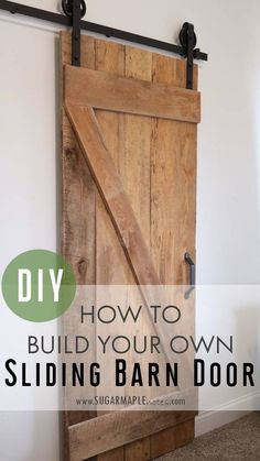 How to make a single sliding barn door DIY. Our sliding barn door made with authentic Wisconsin barn beams adds so much character to our new build. It is the perfect door for our master bedroom closet and adds a rustic touch with the National Hardware sliding door hardware with spoke wheels in oil rubbed bronze.