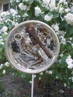 Garden art using hardware in tray set in epoxy