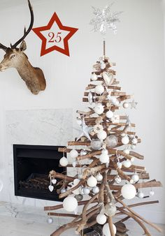 a #Christmas tree from branches (one of 50 ideas to upcycle branches and logs)
