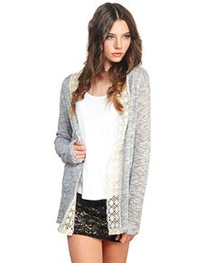 <p>This relaxed crochet trim cardi is made for boho babes and girly girls alike. With pretty crochet lined down the open front, a soft, lightweight slub knit body, and long sleeves, this cardi will transition through the seasons with ease. Keep it simple and dainty when you pair it with a lacey cami, destroyed jeans, and booties.</p>%0D%0A%0D%0A<p>Model wears a size medium.</p>%0D%0A%0D%0A<ul>%0D%0A%09<li>80% Rayon / 10% Acrylic / 10% Cotton</li>%0D%0A%09<li>Hand…