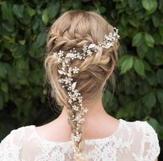 Spring Dawn is a pretty and versatile floral hairvine. Solitaire cut stones are set in an interwoven vine pattern with enamelled flowers and crystals extending along the entire vine. This stunning piece can be worn high on the head as a tiara, woven into a long plait or around a chignon or over the forehead for a more bohemian look.