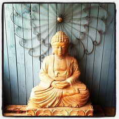 Cast Stone Budda. I have to get one of these for my sister!