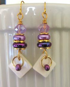 Gold wire purple crystal, glass & gold disc beads, MOP triangle drop dangle earrings. FOR SALE. Please visit my ebay page to see all of my earrings for sale: www.ebay.com/...?::