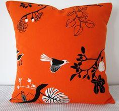 orange, black and white pillow