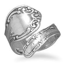 Adjustable sterling silver ring with swirl motif spoon design. This ring is adjustable/bendable but we find that it best fits ring sizes 5-8 .925 Sterling Silver with Antiqued Oxidization. Made in the