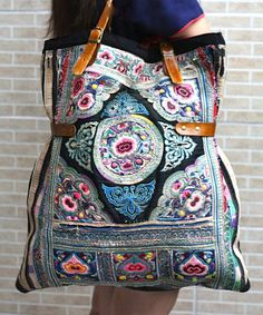 Large enough to hold all my stuff! vintage tribal bags with leather straps and fully lined..... made from old baby carrier fabric from the hill tribes of Thailand.