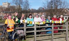Women's Institute Tour de Yorkshire knitted bunting ...something similar (maybe football jerseys?) for around the square