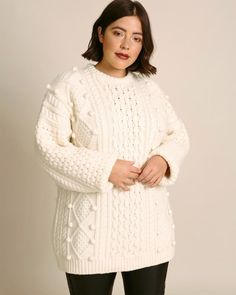 This is as classic as they come. New in plus size from Christopher Kane, pom-pom embellishments dot this Aran cable knit sweater, which has an elongated hem and relaxed silhouette. Cool Sweaters, Cable Knit Sweaters, Day To Night Dresses, Plus Size Designers, Christopher Kane, Feminine Dress, Latest Outfits, Fit And Flare, Plus Size Outfits