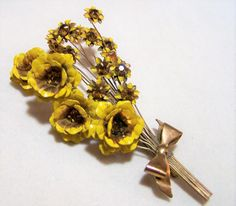 Mid Century painted enamel floral brooch Yellow enamel petals with topaz rhinestone centers on 18 flowers Each flower is on a fine gold tone wire, that trembles with movement, held together by a metal bow Unsigned 4 x 2 1/4 inches Good vintage condition, shows little wear I specialize in vintage rhinestone jewelry, please visit my shop for more selections International buyers welcome, over charges are always refunded Priority shipping is offered 011117  Credit cards and Paypal accepted. ...