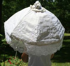Hand sewn Parasol of vintage beaded lace. Bridal umbrella of Ivory lace with taupe underlay. Hand sewn parasol of beautiful ivory embroidered and beaded lace over a shimmering taupe lining. Lace beading includes pearls and sequins $245. www.designAnn.Esty.com