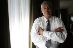 Lorenzo Davis, a former Supervising Investigator who was fired from his position at the Independent Police Review Authority poses for a portrait at his home in Chicago, Illinois July 21, 2015. Davis was terminated from his job after his employer said he refused to change his findings in Chicago police officers involved in cases on excessive force and officer involved shootings.