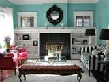 I think I want to paint my wall this teal color. The rest of my decor is black white and a touch of red...