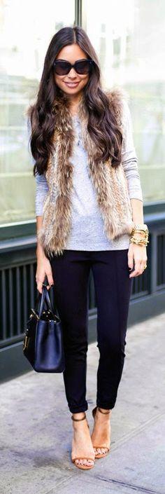 gray shirt, my fur vest, black pants and heels
