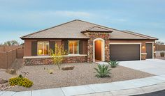 This ranch-style Daniel home in Marana, AZ, reflects its picturesque desert surroundings. The popular plan from Richmond American features a stucco and stone exterior, an elegant arched entryway, a convenient 3-car garage and much more!