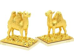 Pair of Golden Camel Cash Flow Protection, $119.99 (http://buy-fengshui.com/pair-of-golden-camel-cash-flow-protection/) This pair of golden Camels beautifully crafted in gold plated metal and standing on a bed of gold ingots, is the perfect remedy for those who are facing a tough times, whether at work, financially or in their personal life. A single-humped camel helps stabilize income and safeguard wealth, while a two-humped camel provides support to overcome financial difficulties.