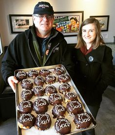 These fine folks from the @BernieSanders campaign stopped by for some doughnuts this morning. They're holding the BOSTON CREAM ones with Bernie's caricature on top. Awesome decorating job by Kim! #vegan by veggiegalaxy February 27 2016 at 04:12AM