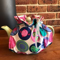 Australian themed reversible wrap around insulated tea cosy with elastic bottom by alittlebirdmademe on Etsy https://www.etsy.com/au/listing/558961971/australian-themed-reversible-wrap-around
