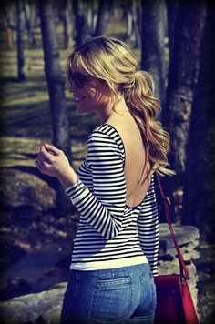 low back tight striped shirt, and bright red purse