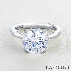 All eyes will be on your center diamond, in this not so simple solitaire round cut diamond engagement ring. A sleek band with secret diamond details along the inner face of the band brings your brilliant round cut diamond to life, making it worthy of your love. Tacori RoyalT HT2625RD10