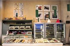 Βιτρίνα γεμάτη γλυκά με ήθος στο Ζαχαροπλαστείο 'Φύσις'. Liquor Cabinet, Photo Wall, Storage, Frame, Furniture, Home Decor, Purse Storage, Picture Frame, Photograph