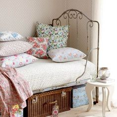 Art Ideas for a vintage style bedroom for little girl.  I like the mix of fabrics in this room, the iron bed and the wicker case under the bed. home