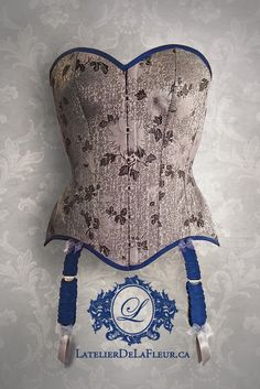 Intended for regular wear and light training, this elegant corset silhouette has a gentle waist reduction and hidden bust support concealed behind a pretty cotton lining. The garters are the epitome of luxury; ruched silk, with silver satin garter covers and petite organza bows. Beautiful-but-strong satin ribbon lacing brings all the contrast together. Corset Costumes, Waist Cincher, Cowboy Boots, Bows, Corsets, Elegant, Lace, How To Wear, Cotton