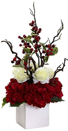 A table-top centerpiece that celebrates Winter, the Holiday Cheers Arrangement with Vase provides a splash of color to your décor year after. Christmas Flower Arrangements, Flower Arrangements Simple, Artificial Flower Arrangements, Christmas Flowers, Christmas Centerpieces, Artificial Flowers, Christmas Wreaths, Christmas Decorations, Holiday Decor