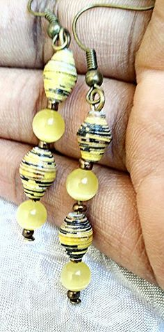 Bronze toned yellow paper bead dangle earrings by ChinniAbhi for $5.00