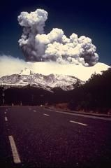 An eruption plume rises above the summit of Ruapehu on November 11, 1977, as seen from 5 km north of the summit on the ski area access road near Faukepapa village. Minor phreatic eruptions began in July, and lasted until January 1979. The larger explosions in November produced pyroclastic surges in the summit crater area and a lahar down the Whagaehu River on the east flank.
