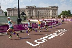 Athletes pass the two mile mark in the 2012 Olympic Men's Marathon, with Buckingham Palace in the background.
