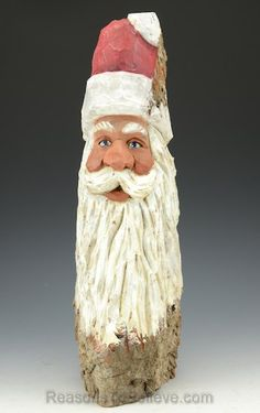 """""""A wonderful Santa head carved into a large piece of cottonwood bark. The piece stands on its own and is just under 14 inches tall. A hand crafted Santa Claus figure, carved from solid wood. Designed, carved by hand, painted, finished and signed by Russell Scott."""""""