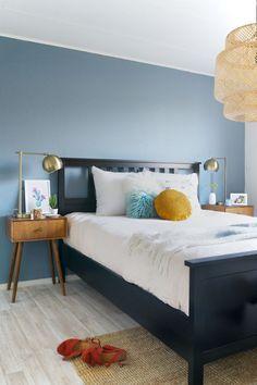 Mid century inspired bedroom with denim drift. Beautiful.