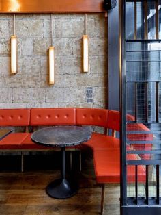 Almost orange-red. Like the use of a round table for the curve in the booth vs the square table next to it. Those light fixtures are cool, but maybe too modern for us? The whole image plays nicely with texture. Banquet Seating, Cafe Seating, Booth Seating, Lounge Seating, Restaurant Booth, Restaurant Seating, Restaurant Design, Design Café, Cafe Design