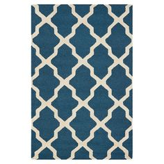 Anchor vibrant decor or bring a pop of pattern to neutral palettes with this hand-tufted wool rug, showcasing a timeless trellis motif.