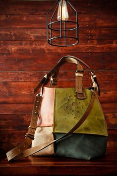 Oversized brown leather bag, with long shoulder strap . Inside big zippered pocket, bag is closed by magnetic clasp. Made from nice ginger/lemon/ brown