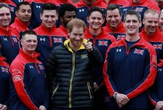 Prince Harry poses with some of the UK Invictus team who will be participating in the Orlando Games