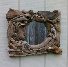 This is a hand made mirror. It measures 16x15x3 inches. The mirror is a 7 inch round mirror. Check out my other items at: Etsy.com/shop/burlgirlcreations Please contact me with any questions. I happy to answer them. *US Sales only*