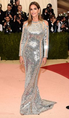 CINDY CRAWFORD in a liquid silver Balmain gown with sheer sleeve panels. Met  Gala 2016