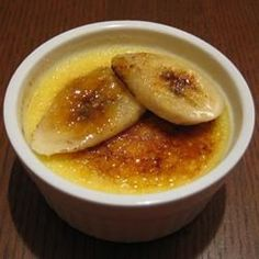 A wonderful baked creme brulee.  Use white or brown sugar for the top. If you do not have a kitchen torch, a regular propane torch can be used or simply place the custard under the broiler for a few minutes.