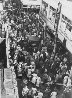 Electric Lane Brixton with Market Row on the right 1952 South London, Old London, Brixton Market, London Market, London Photography, British History, The Row, Times Square, Marketing