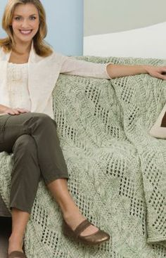 Double Delight Throw Knitting Pattern - Cables and diamonds are combined for this charming design. Make it for a special wedding or anniversary gift or to add relaxed style to your own room.